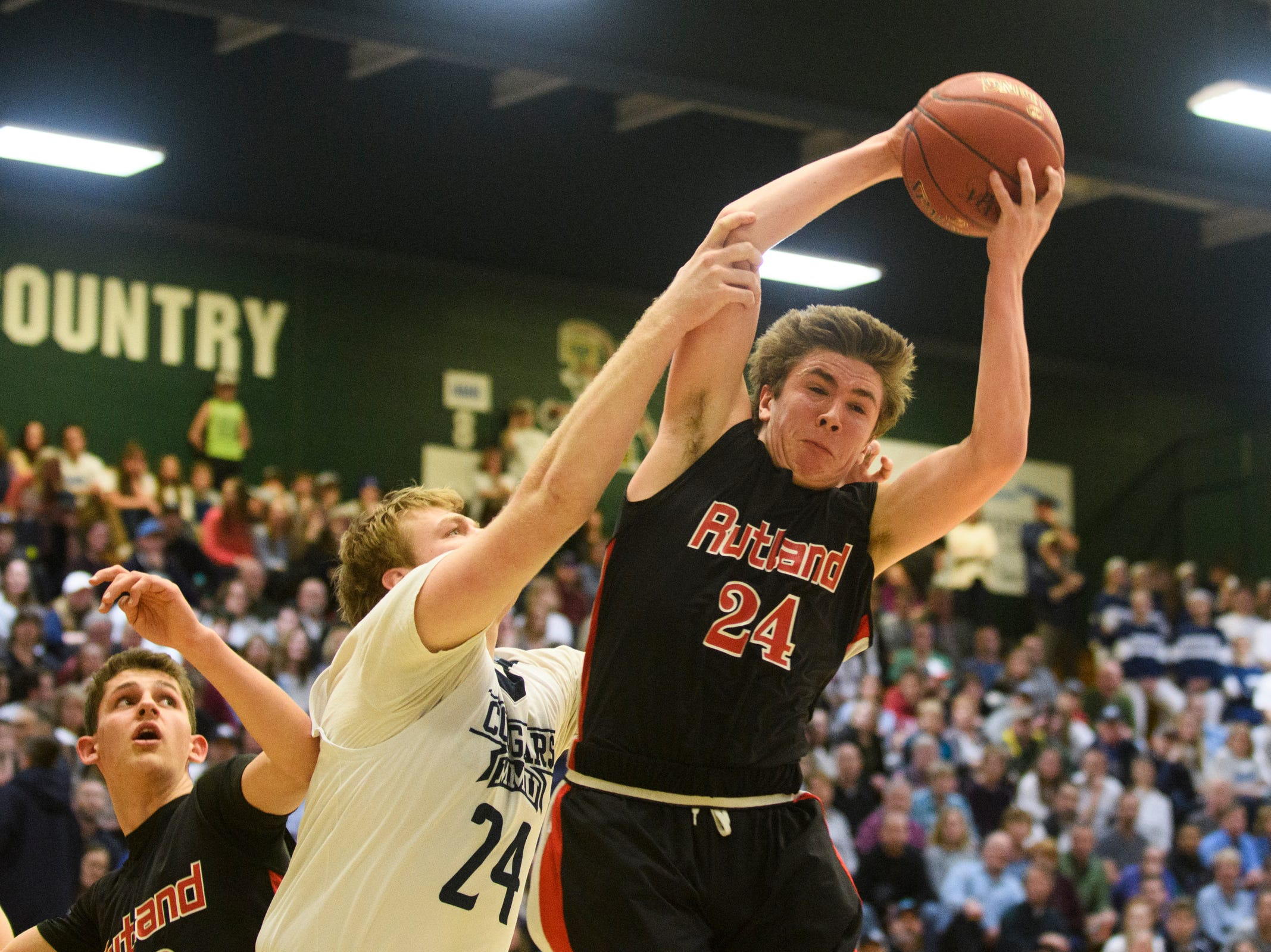 Rutland's Jacob Lorman (24) leaps to grab the rebound during the boys DI semi final basketball game between the Rutland Raiders and the Mount Mansfield Cougars at Patrick Gym on Monday night March 11, 2019 in Burlington, Vermont.