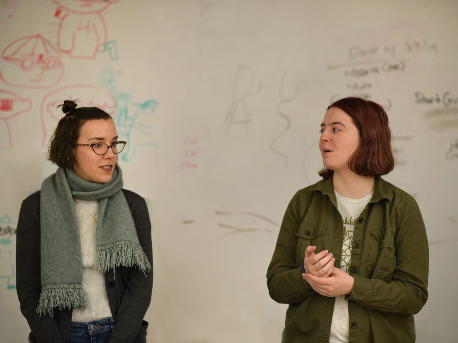 Champlain College seniors Amila Nuhodzic, left, with  Jennifer Carlin in a collaborative design classroom on March 5, 2019. Nuhodzic, of Burlington, co-founded local indie Fat Bird Studios, and helped create Querent, a game that uses tarot cards (illustrated by Nuhodzic). The group hopes to find a publisher at a conference this month.
