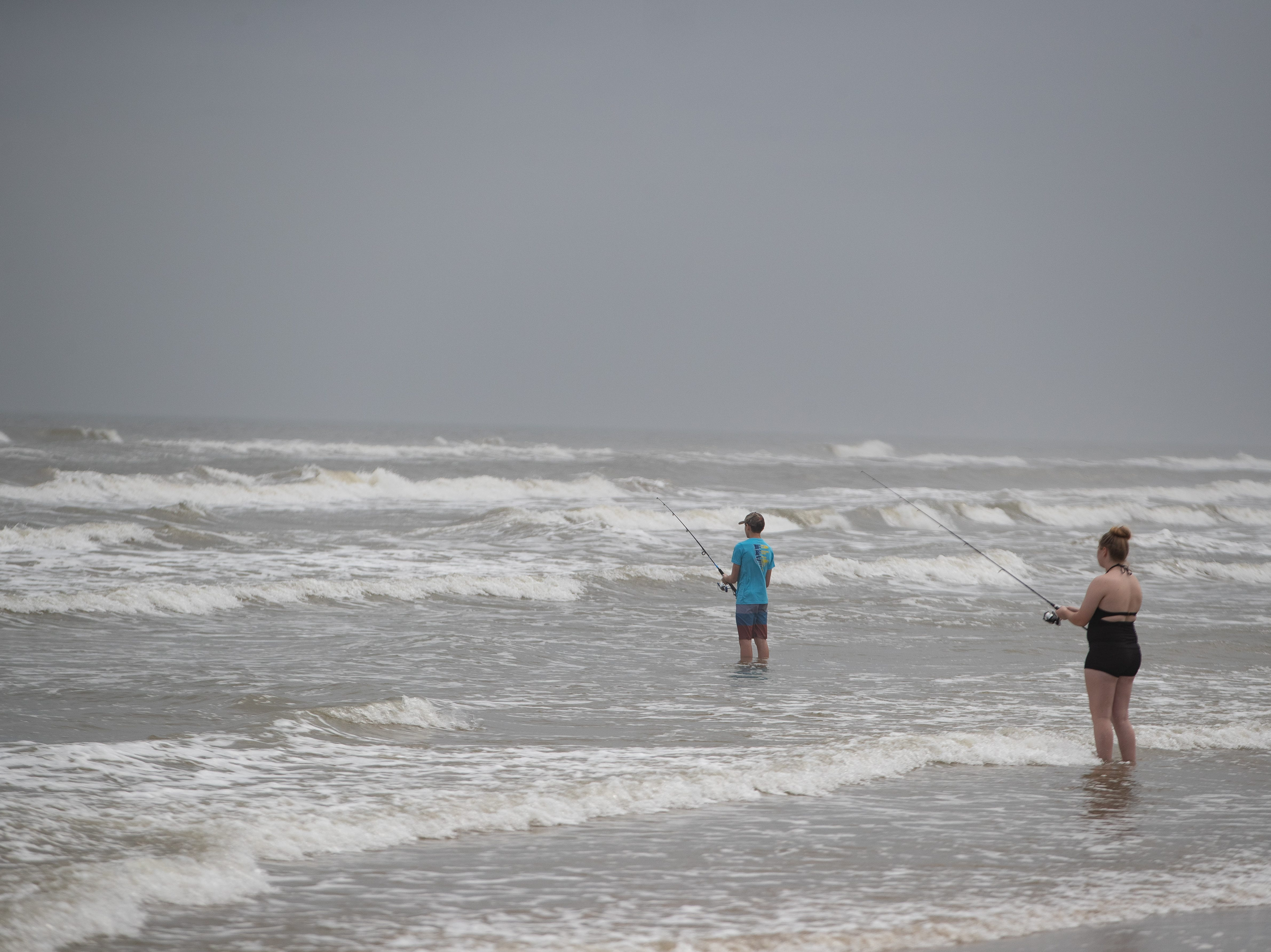 People fish as they celebrate spring break 2019 on the beach in Port  Aransas on Monday, March, 11, 2019.