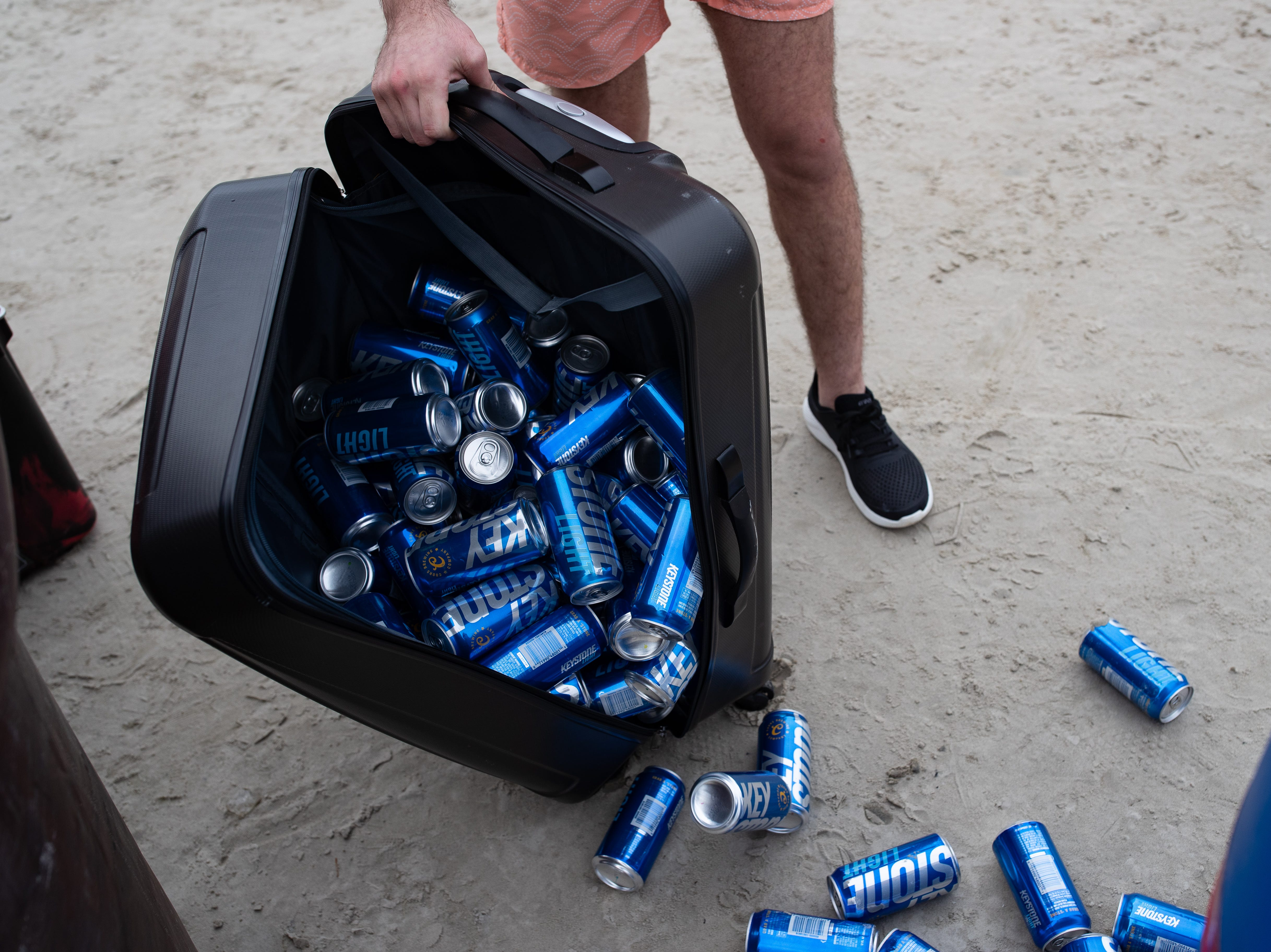 Police make spring breakers dump their alcohol on the beach in Port  Aransas on Monday, March, 11, 2019.