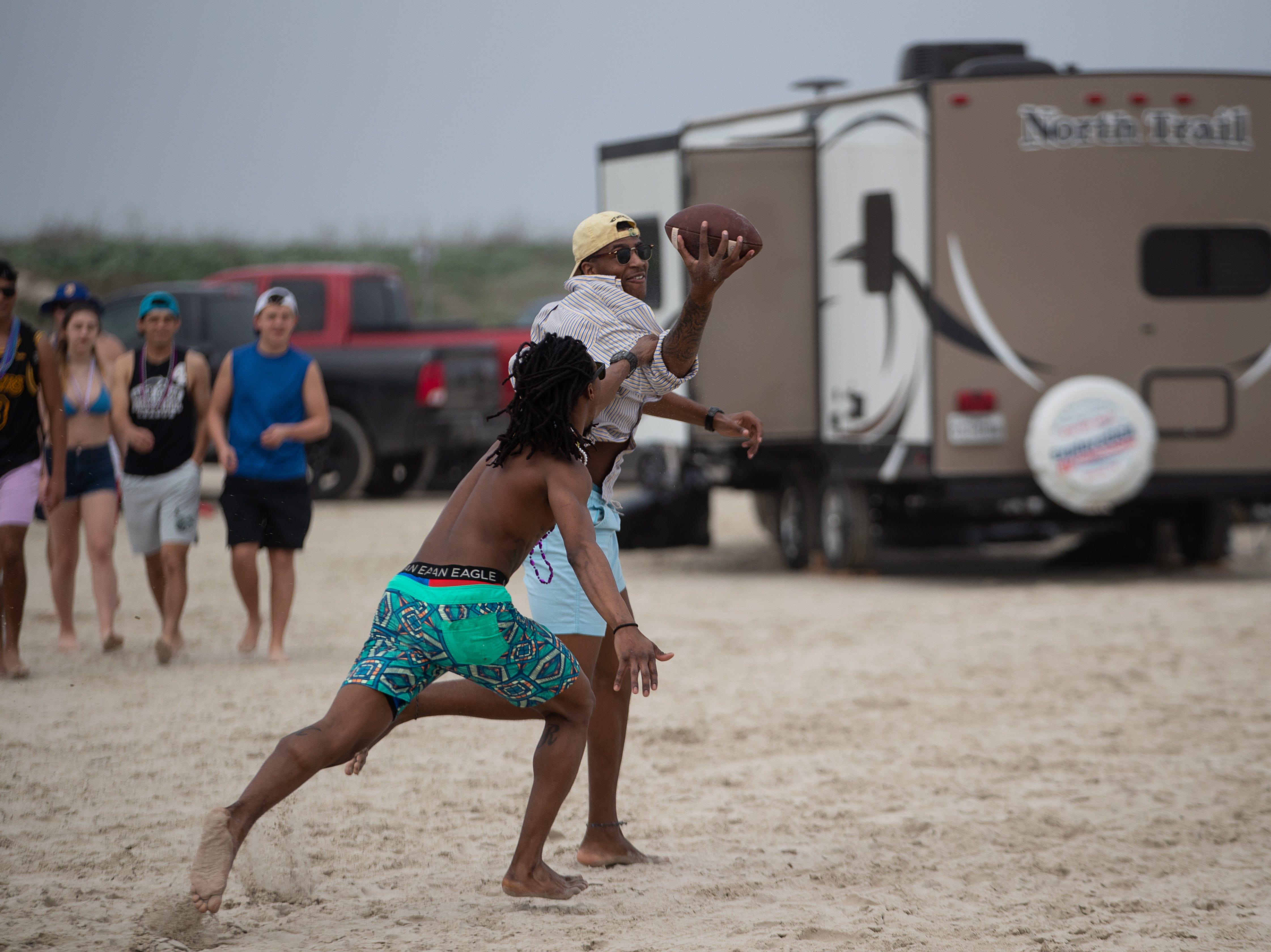 People celebrate spring break 2019 on the beach in Port  Aransas on Monday, March, 11, 2019.