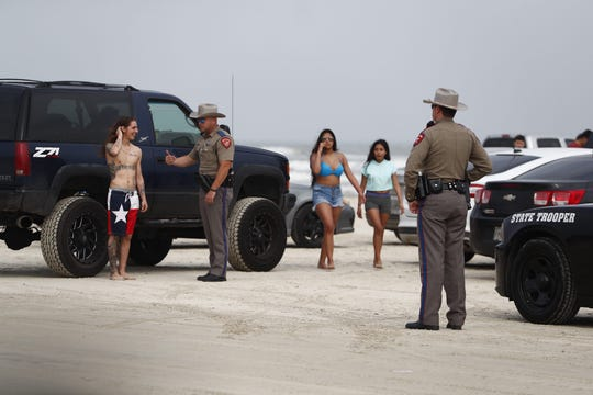 Authorities make their presence known to revelers during spring break events in Port Aransas on Tuesday, March 12, 2019.