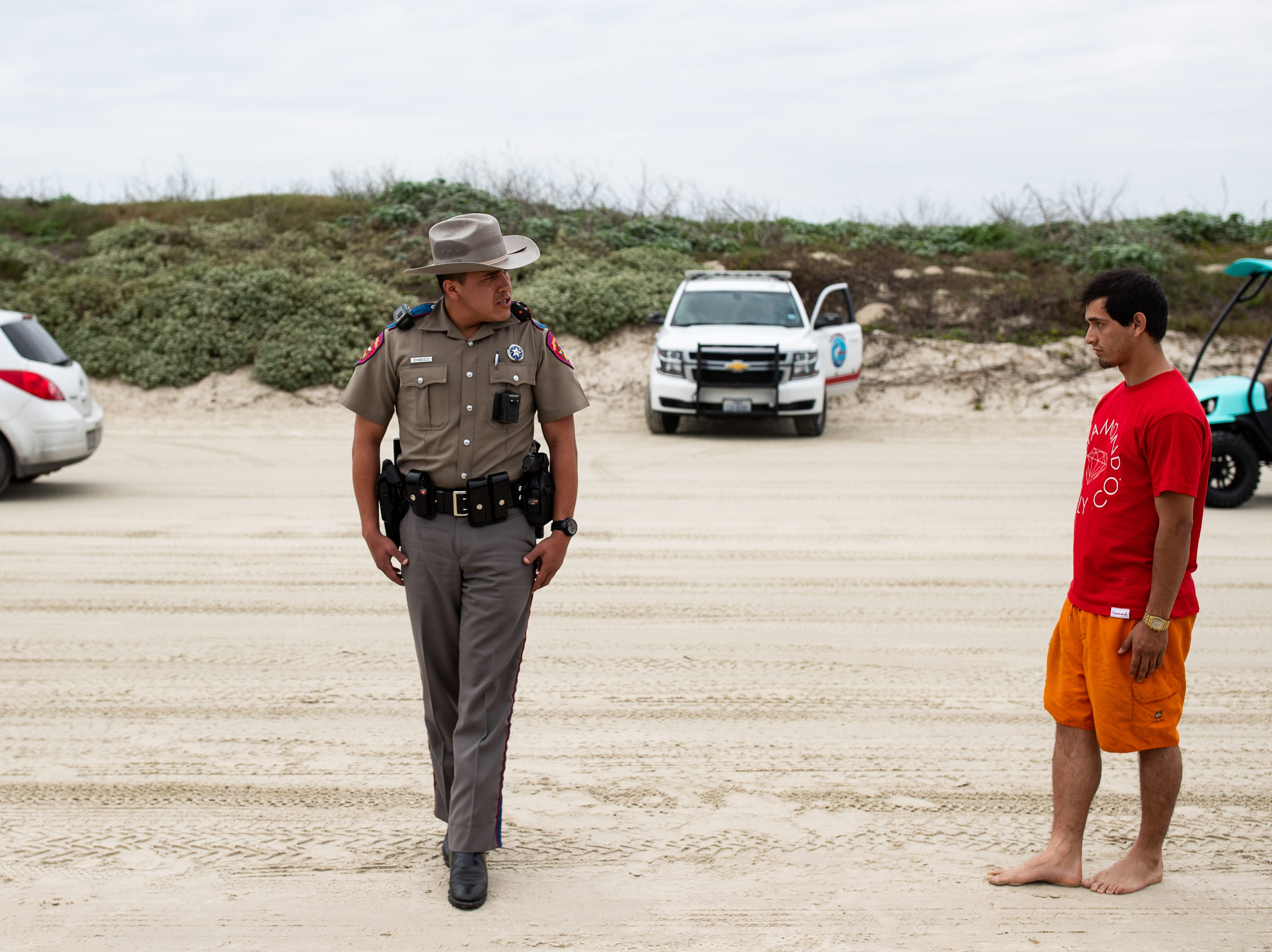 A DPS trooper administers a field sobriety test as people  celebrate spring break 2019 on the beach in Port  Aransas on Monday, March, 11, 2019.