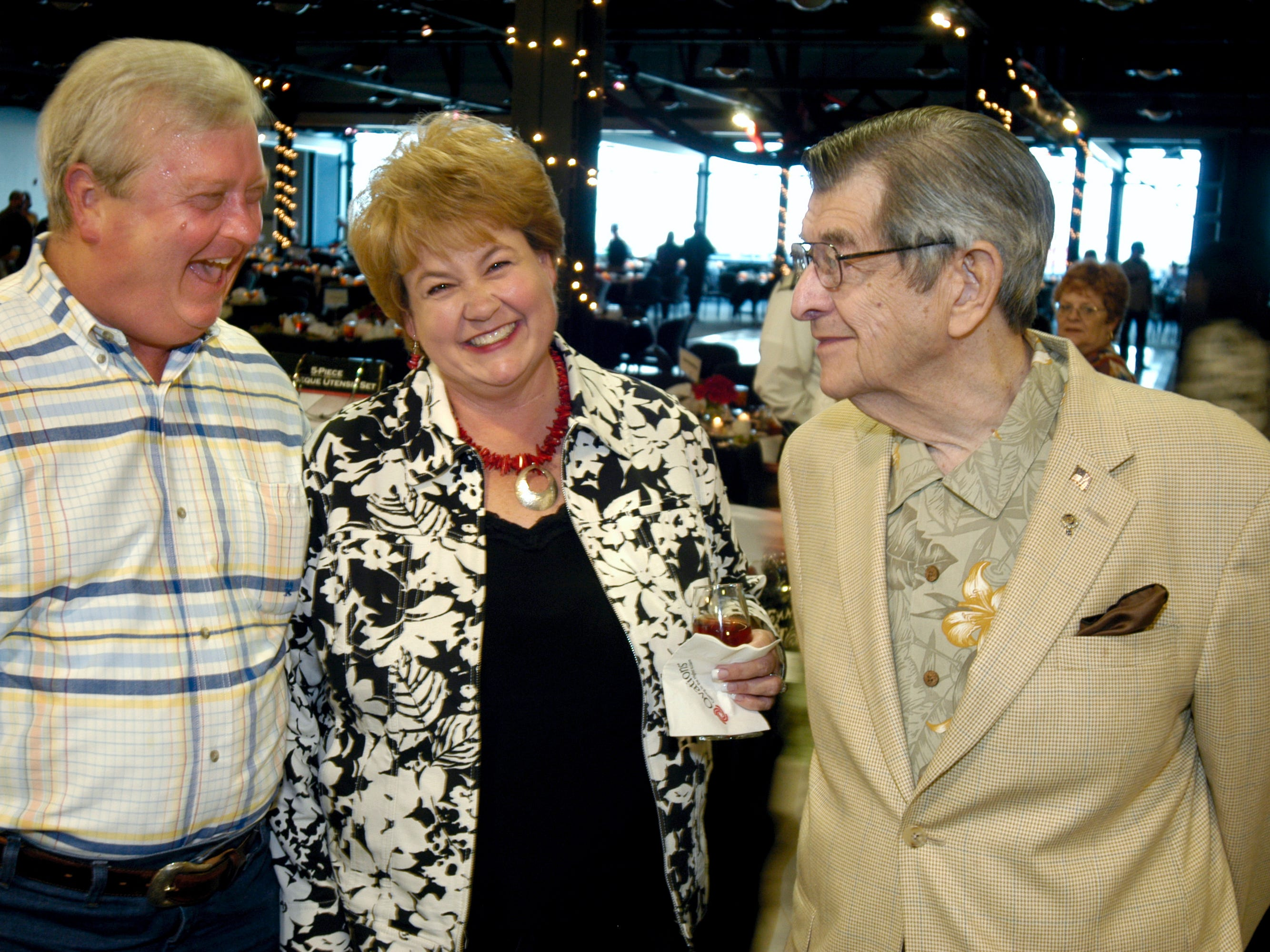Alan Wilson (from left) Catrina Wilson and Joe Sheinberg  attend a Great Expectations fundraiser, benefiting the Women's Shelter of South Texas, now the Purple Door, in 2009.