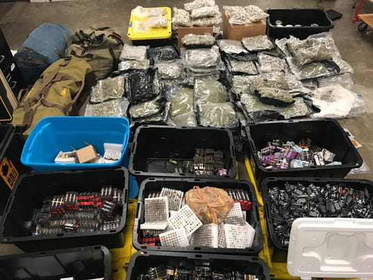 Law enforcement reported seizing the pictured drugs - including suspected marijuana, cocaine, LSD - from a Jasonway Avenue apartment. Officials say the drugs have a street value of about $2.3 million.