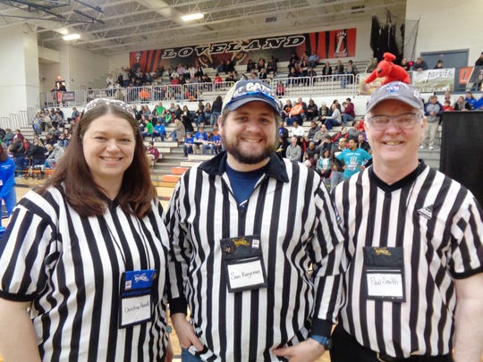 Hundreds of volunteers like Christina Hancock, Sam Kunzeman, and Paul Smith make a difference helping prepare kids for futures in science, technology, engineering and math  at the i-SPACE Ohio First Tech Challenge State Championship for robotics at Loveland High School.