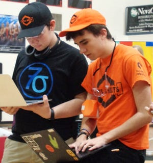FTC robotics State Champion 7 Sigma captain Andrew Motz from Anderson Township workswith first alliance partner  Jackson Daumeyer of Loveland team 5040-Nuts & Bolts at the i-SPACE Ohio First Tech Challenge State Championship for robotics at Loveland High School.
