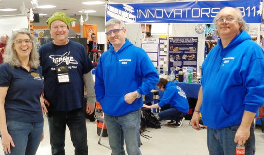 i-SPACE program manager Lori McAlister with State Championship tournament volunteer Chad Royal and Dayton Innovator Robotics team 3311 coaches Lou Pochet and Keith Grinstead at the state championship at Loveland HIgh School.