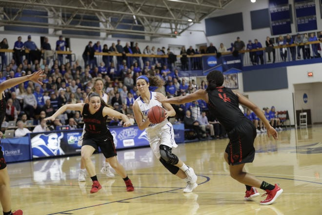 Madison Temple of Thomas More University prepares to pass in the Elite 8 game versus No. 22-ranked Washington University. She had 36 points in that 87-72 March 9.