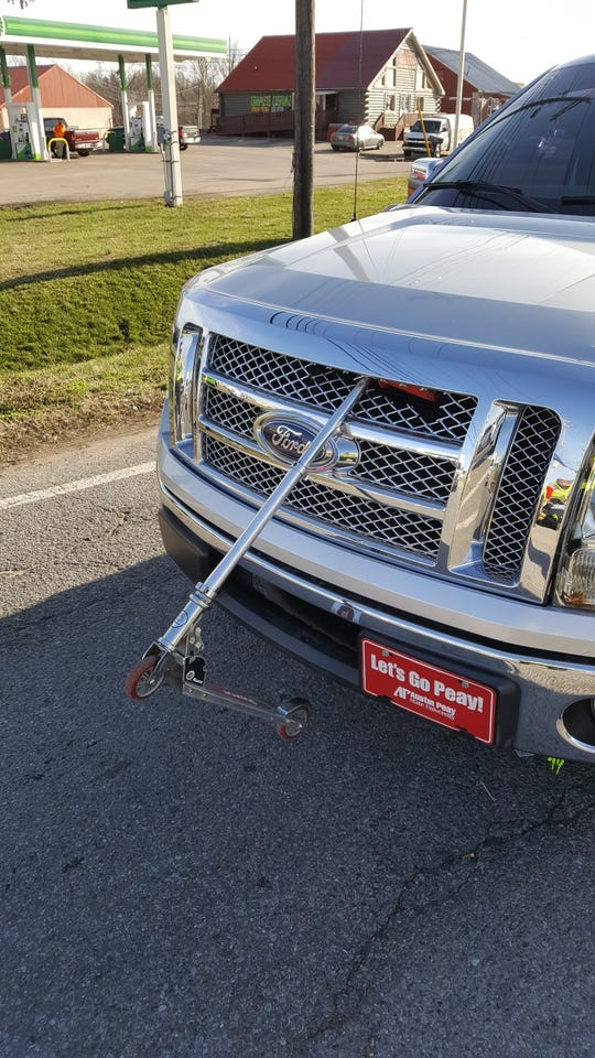 A Razor scooter embedded in the front of a pickup truck after a pedestrian was hit on Wilma Rudolph Boulevard Monday, March 11, 2019.