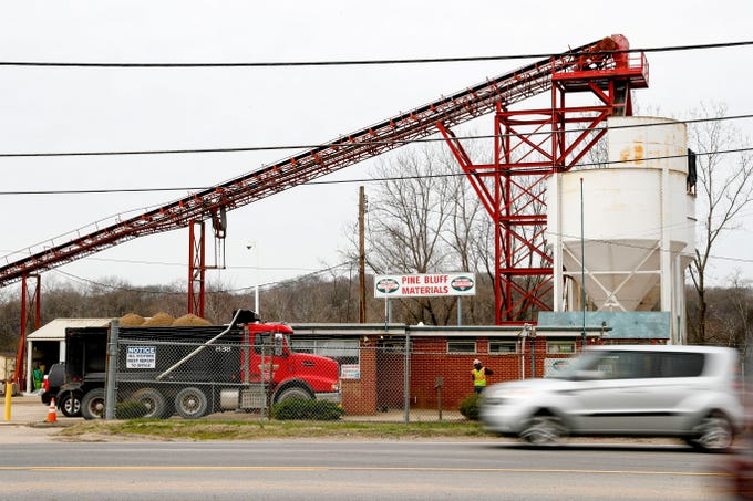 Trucks pull up before departing with materials while barges are halted due to river flooding at Pine Bluff Materials in Clarksville, KY., on Tuesday, March 12, 2019.