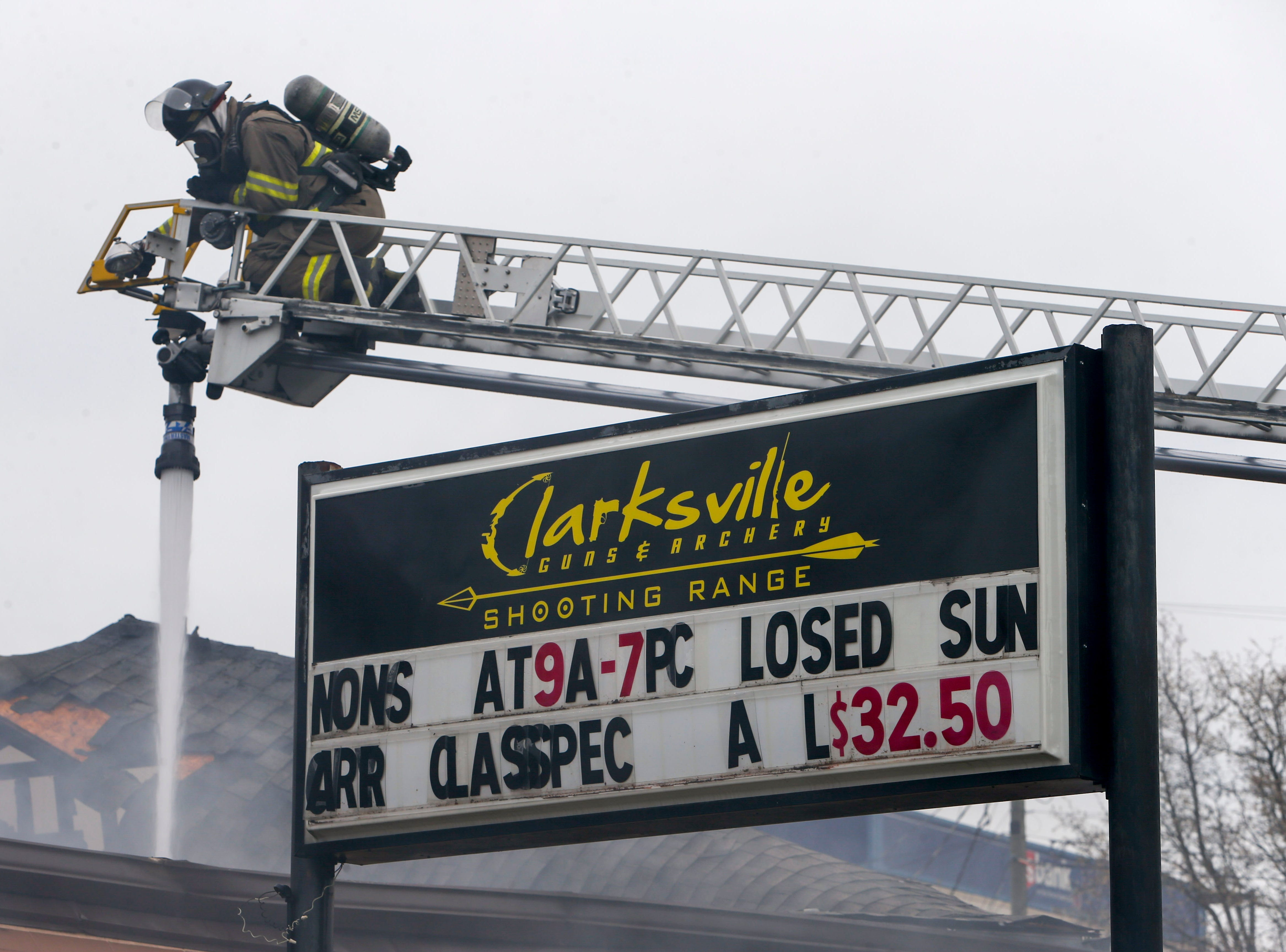 A Clarksville firefighter continues to spray down the inside of a shooting range at Clarksville Guns & Archery in Clarksville, Tenn., on Tuesday, March 12, 2019.