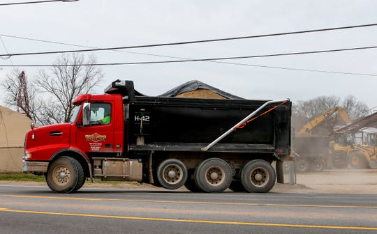 A truck pulls out of the lot with a load of material at Pine Bluff Materials in Clarksville, KY., on Tuesday, March 12, 2019.