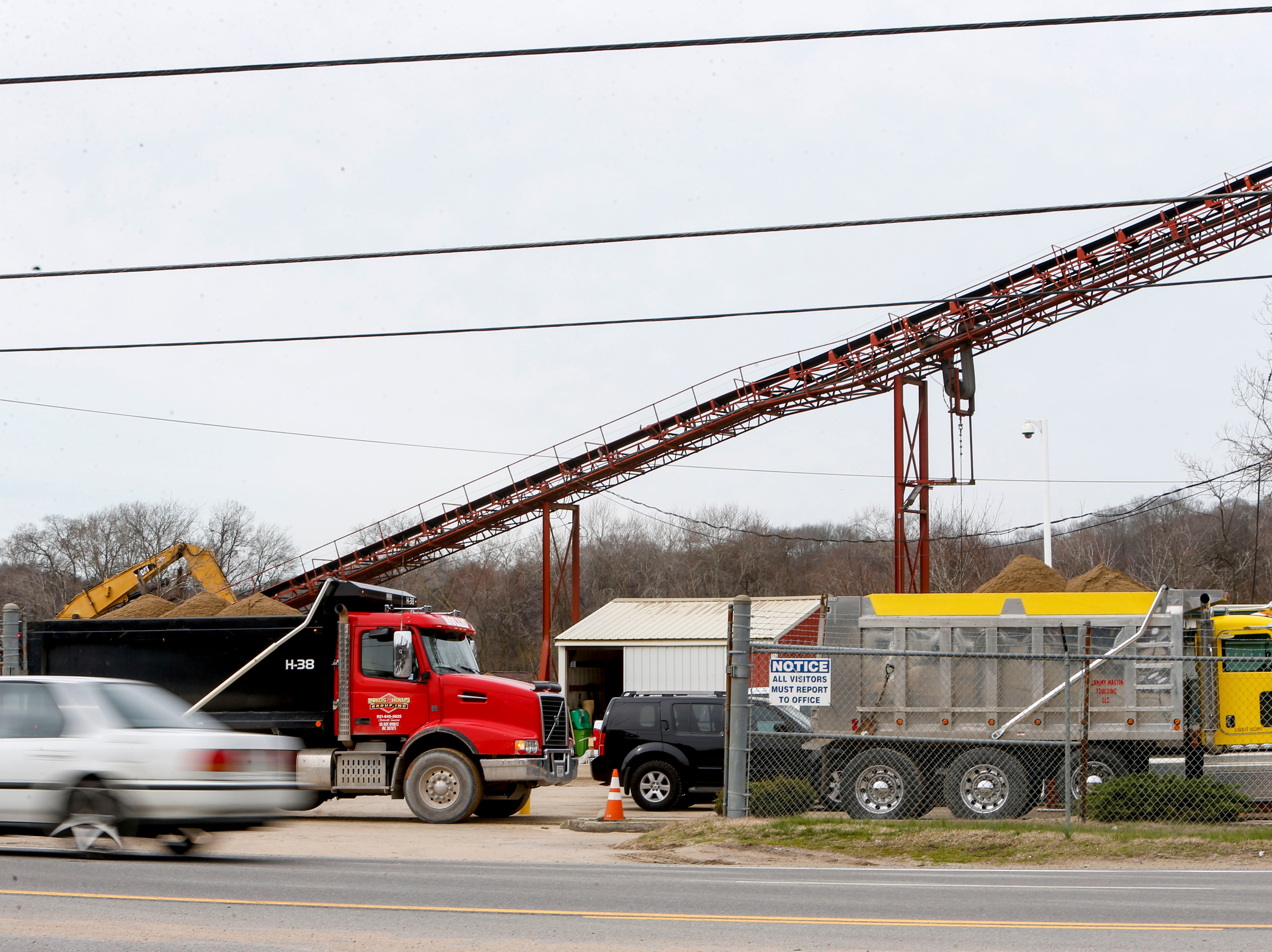 Trucks wait inside the lot with their beds full to transport material while barges cannot travel the river at Pine Bluff Materials in Clarksville, KY., on Tuesday, March 12, 2019.