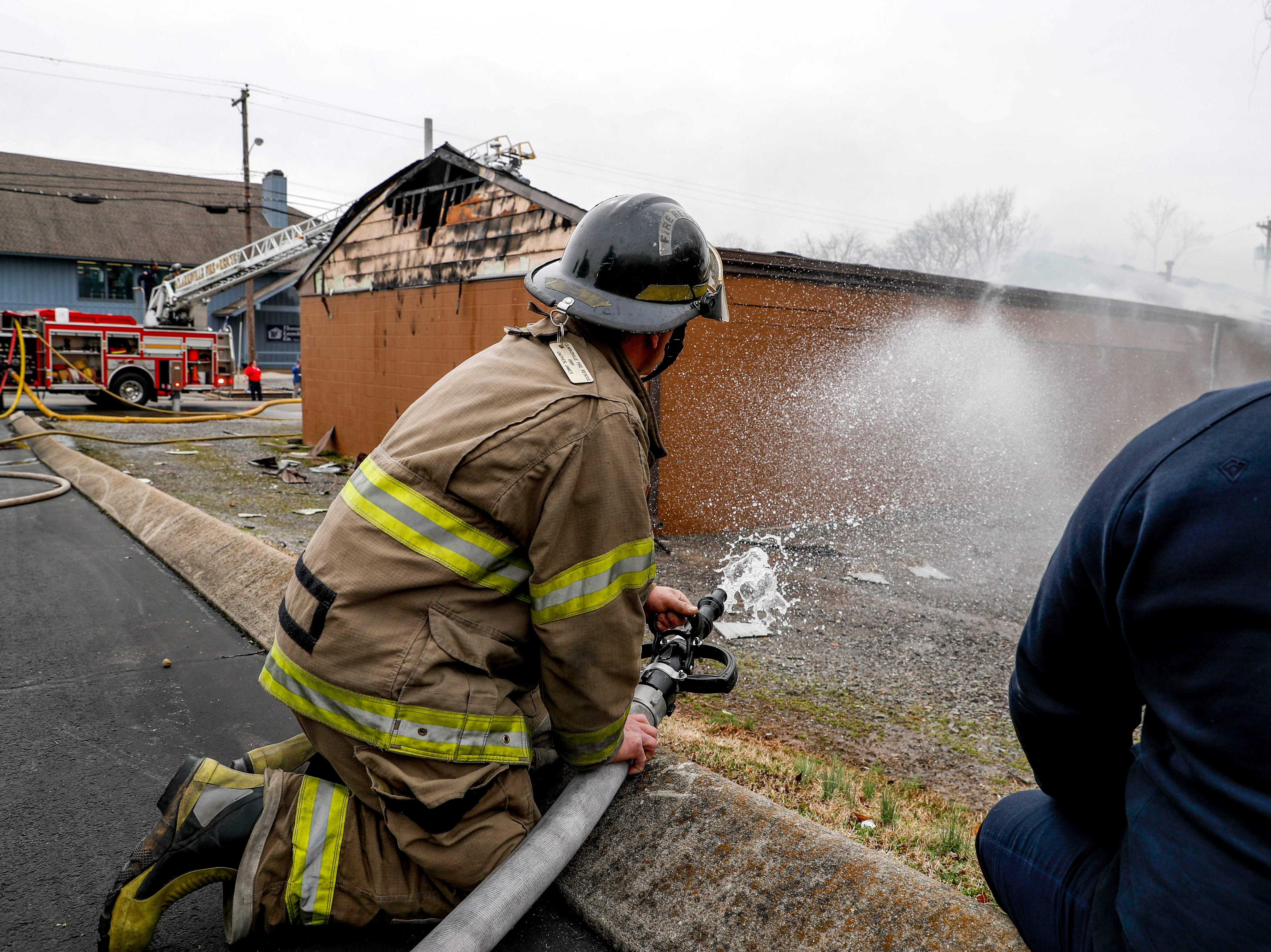 Clarksville Fire Rescue responders spray water to put out flames at Clarksville Guns & Archery in Clarksville, Tenn., on Tuesday, March 12, 2019.