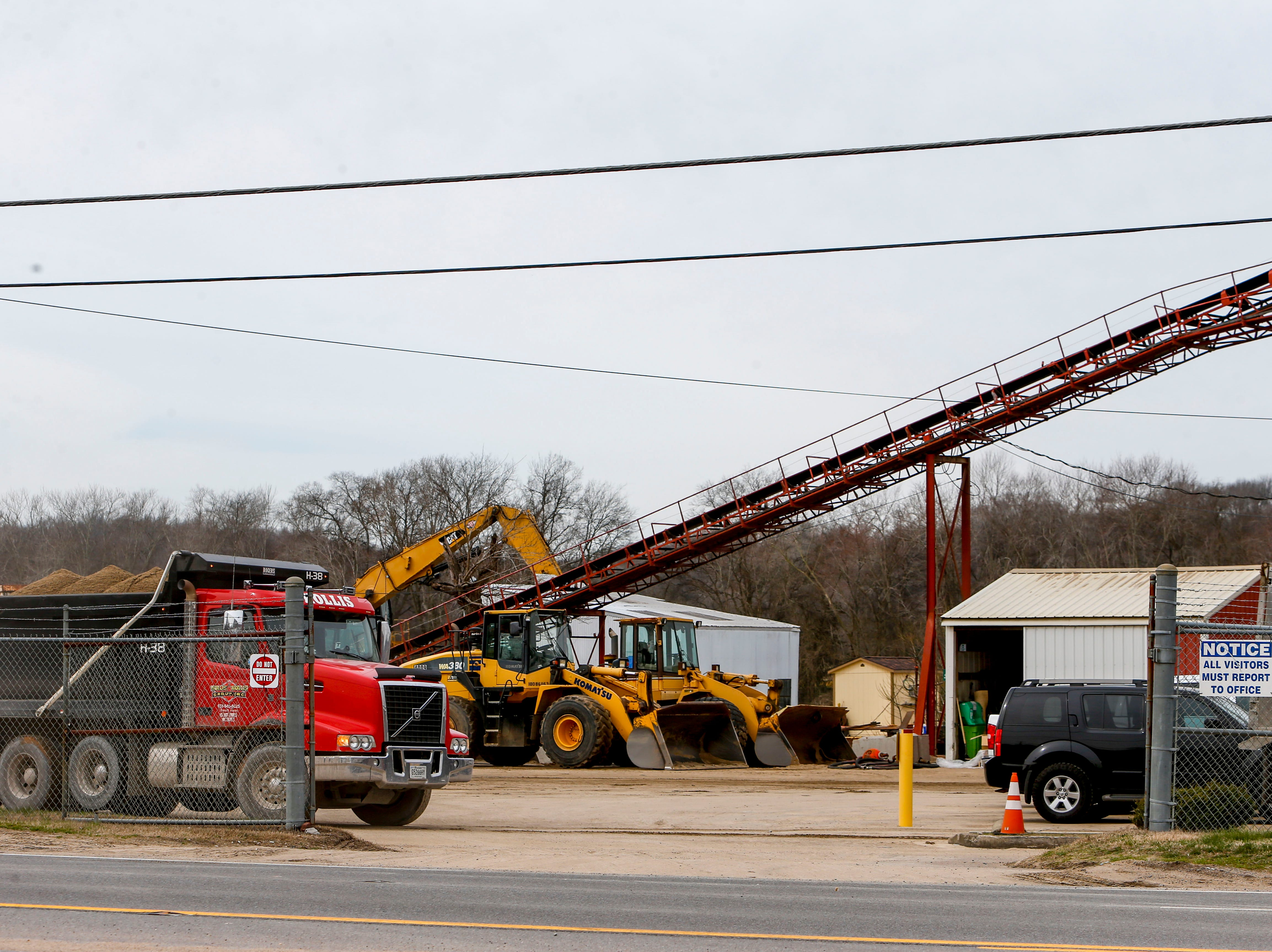 Trucks depart with loads of material while barges cannot travel the river at Pine Bluff Materials in Clarksville, KY., on Tuesday, March 12, 2019.