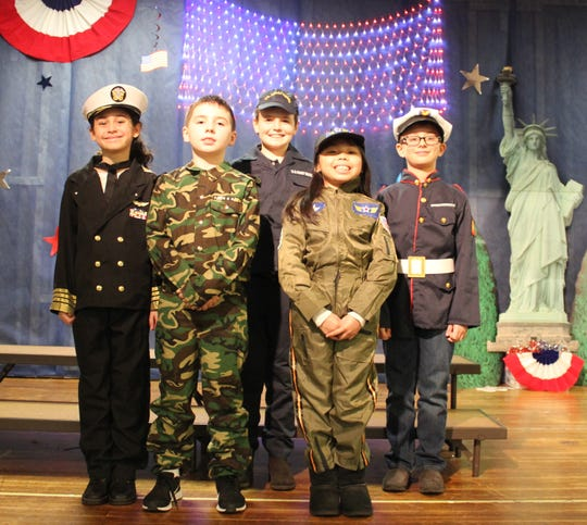 St. Francis Cathedral School third and fourth graders presented their  annual Patriotic Program on Wednesday, Feb. 27. Left to right: Ava Foti, Michael Hornby, Dylan Patterson, Isabella Eleazar and Gabriel Nelson. The students sang songs and performed with speeches that celebrate the history of our great nation.