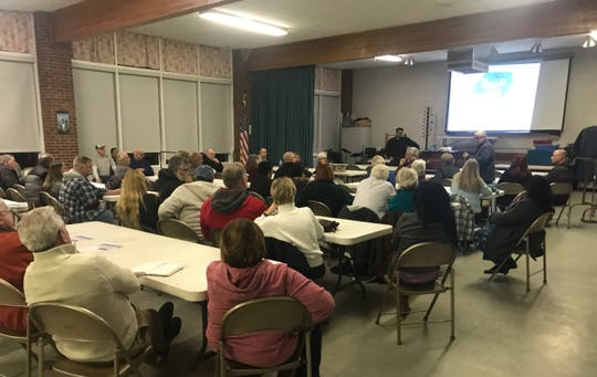 Edison residents discuss Suez North America's proposed $811 water and sewer deal with the township at March 13 at Grace Reformed Church. The discussion included a power-point presentation by Food & Water Watch addressing concerns about Suez's rates and service quality.