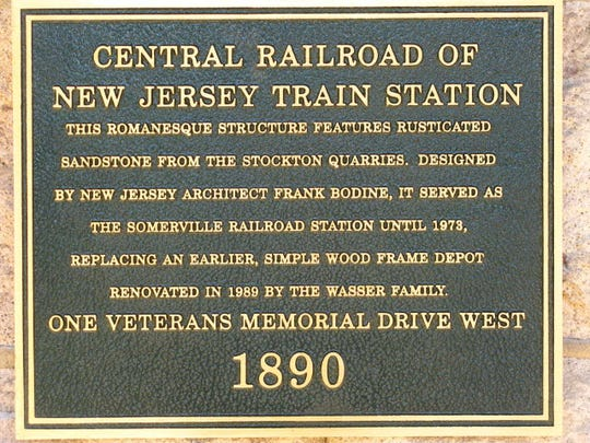 A plaque describes the historical significance of the Somerville train station.