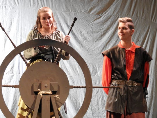 "Kenzie Potter and Peter Szucs  in a scene from ""The Pirate Queen"" playing this weekend at Coshocton High School. The musical details the true story of Grace O'Malley, an Irish sailor who defied Queen Elizabeth in the 16th century."