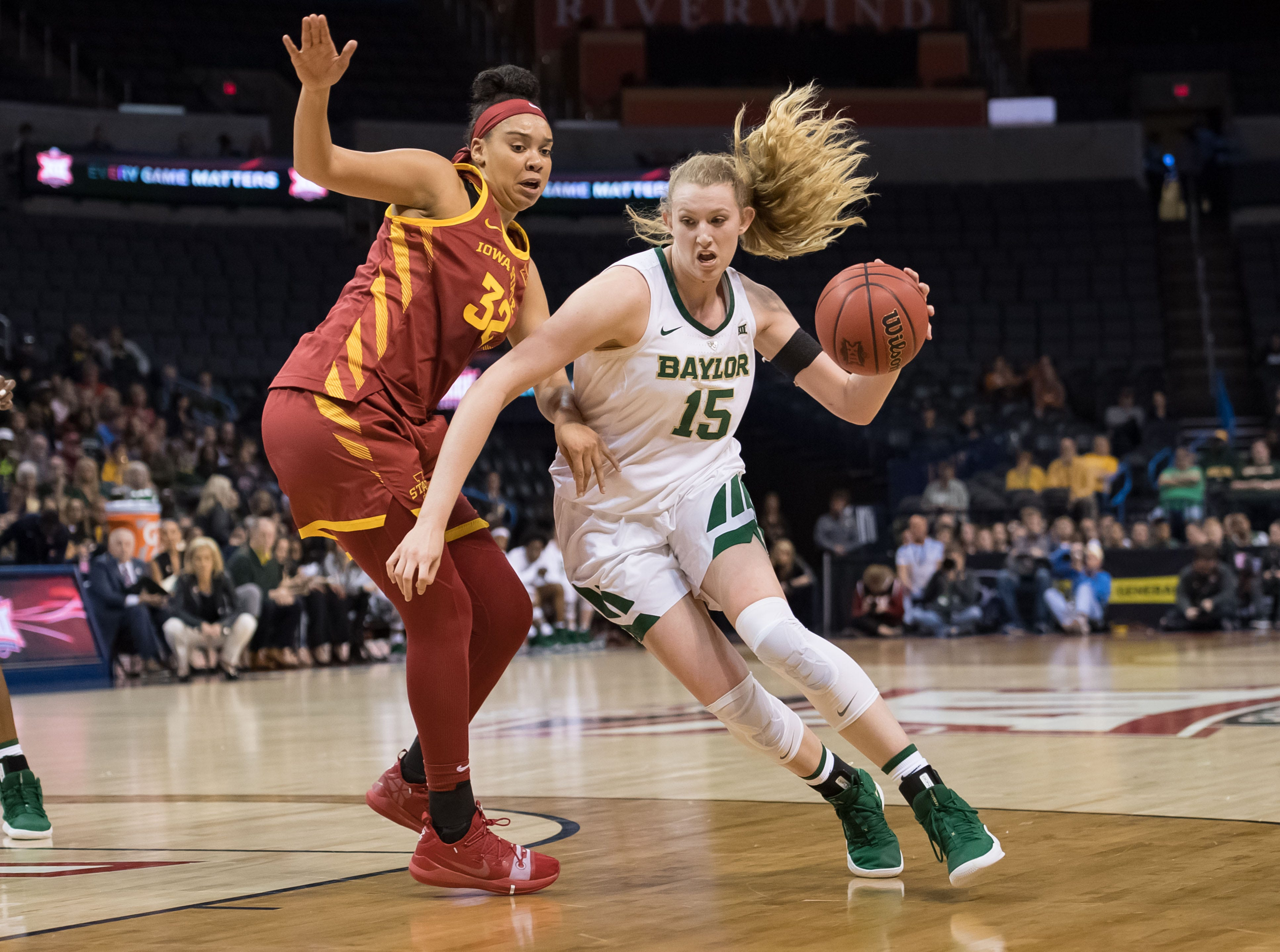 Baylor Lady Bears forward Lauren Cox (15) drives to the basket against Iowa State Cyclones forward Meredith Burkhall (32) during the second quarter in the women's Big 12 Conference Tournament at Chesapeake Energy Arena.