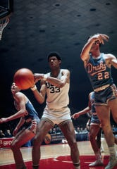 From 1969: UCLA center Lew Alcindor (33), who later became known as Kareem Abdul-Jabbar, fights for a loose ball against Drake University's Rick Wanamaker (43) and Gary Zeller (22) in the NCAA Final Four.  UCLA defeated Drake 85-82.