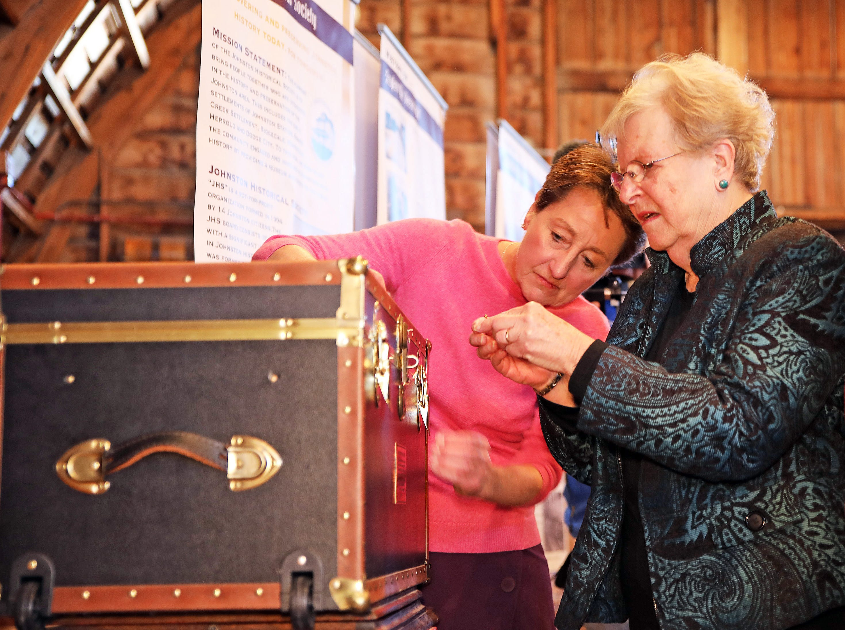 Johnston Mayor Paula Dierenfeld and past President of the Johnston Historical Society Mary Jane Paez work to unlock the treasure chest during the opening of the 25-year old time capsule from 1994 as the city of Johnston celebrates its 50th anniversary at the Simpson House and Barn Museum at 6161 Northglenn Drive on Sunday, March 10, 2019, in Johnston. The city was incorporated in 1969 with 2,236 residents and 50 years later, over 21,000 residents call Johnston home.