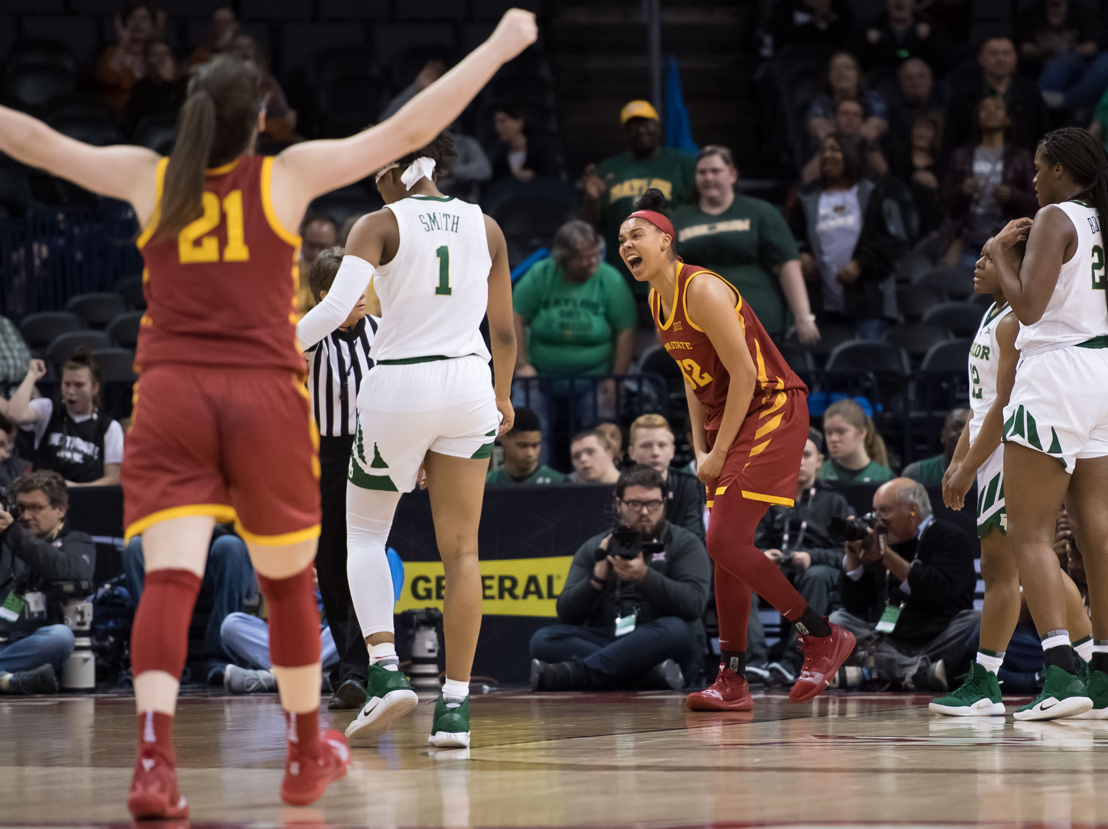 Iowa State Cyclones forward Meredith Burkhall (32) reacts after scoring and drawing a foul against the Baylor Lady Bears during the second quarter in the women's Big 12 Conference Tournament at Chesapeake Energy Arena.