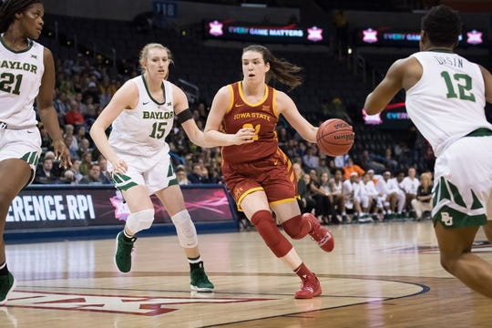 Iowa State Cyclones guard Bridget Carleton (21) dribbles past Baylor Lady Bears forward Lauren Cox (15) during the third quarter in the women's Big 12 Conference Tournament at Chesapeake Energy Arena.