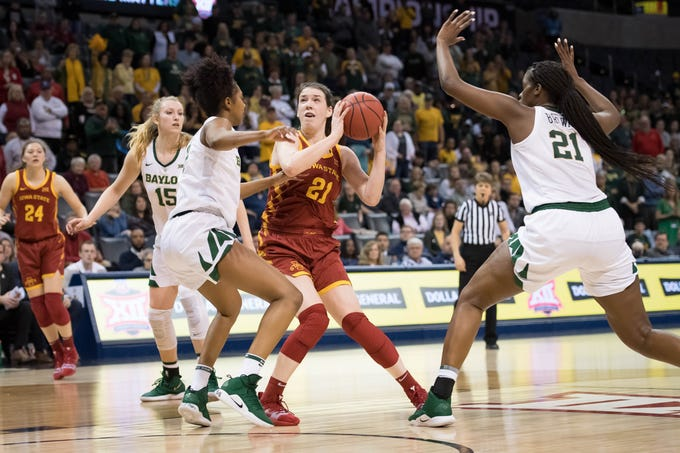 Iowa State Cyclones guard Bridget Carleton (21) pulls up to shoot while defended by Baylor Lady Bears guard DiDi Richards (2) during the fourth quarter in the women's Big 12 Conference Tournament at Chesapeake Energy Arena. Baylor won 67-49.