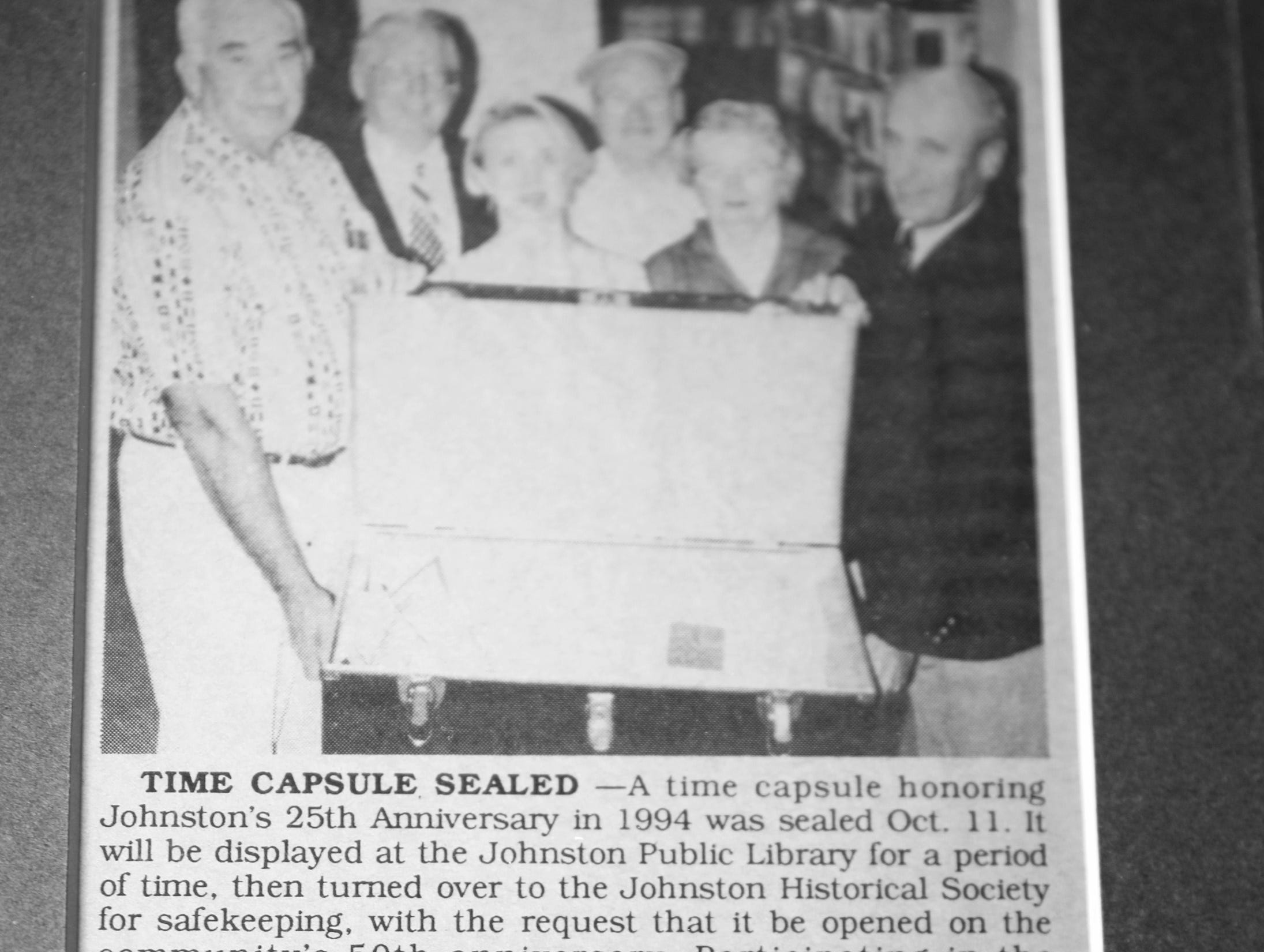 The framed set of keys and a 1994 photo (with then Johnston Library Director Lori Belknap) to document Day One of the treasure chest during the opening of the 25-year old time capsule from 1994 as the city of Johnston celebrates its 50th anniversary at the Simpson House and Barn Museum at 6161 Northglenn Drive on Sunday, March 10, 2019, in Johnston. The city was incorporated in 1969 with 2,236 residents and 50 years later, over 21,000 residents call Johnston home.