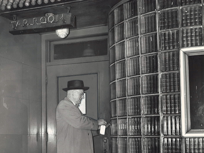 From 1948: Sheriff Howard Reppert removes a padlock from the front door of Babe's Taproom, 417 Sixth Street in Des Moines, upon expiration of a one-year court padlocking under a liquor injunction.