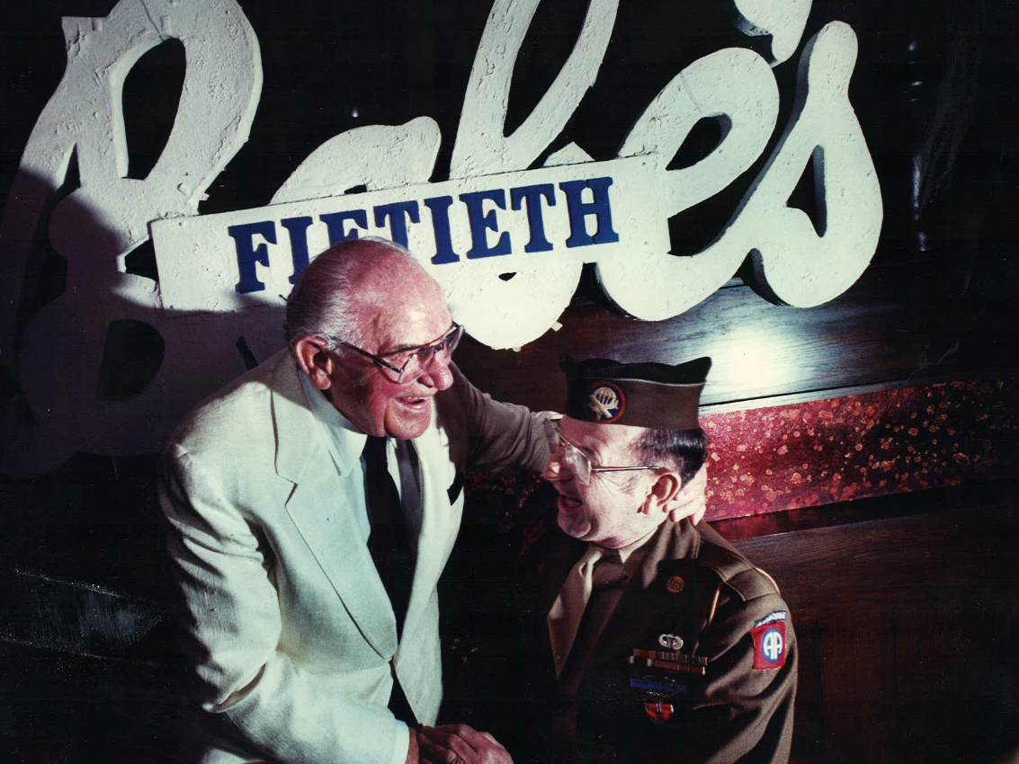 From 1989: Babe Bisignano, left, celebrates the 50th anniversary of his Des Moines restaurant, Babe's. Joining Babe in the revelry is Jimmie Good of Dallas Center who, in 1946 with about 40 other servicemen, was arrested by military police at Babe's request for being too rowdy in the downtown restaurant. Babe offered a special for any serviceman who wore their uniform to the celebration.