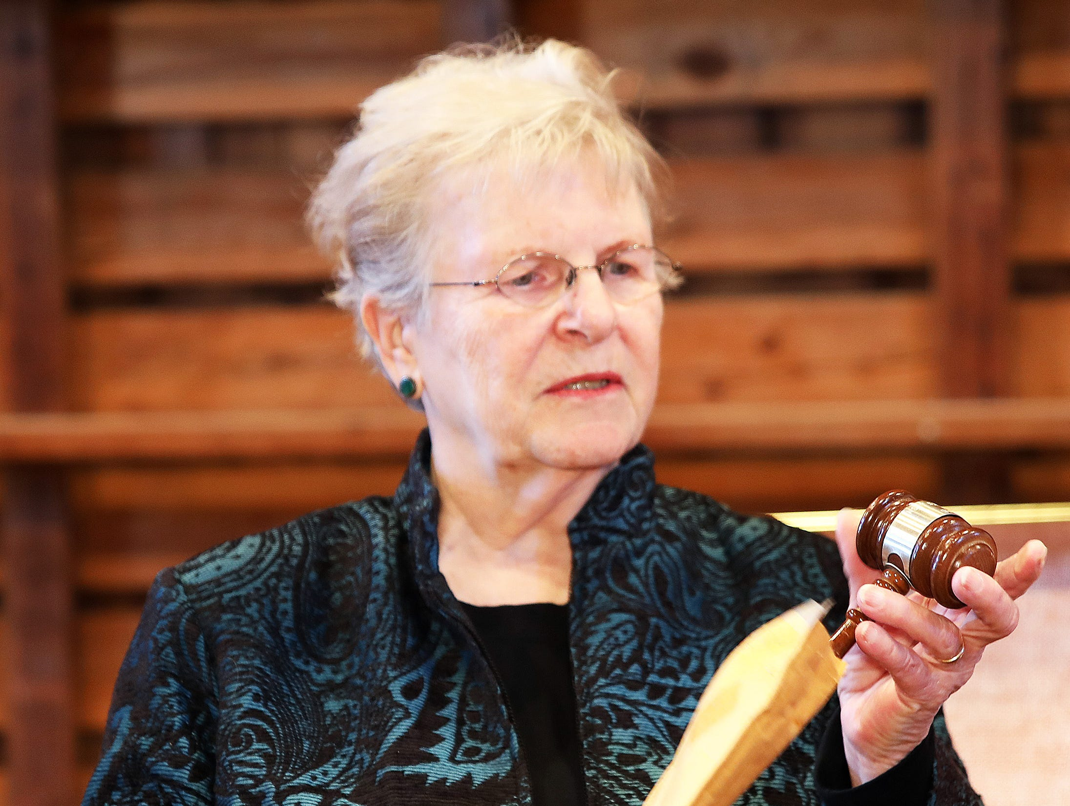 Past President of the Johnston Historical Society Mary Jane Paez unwraps the mayor's gavel during the opening of the 25-year old time capsule from 1994 as the city of Johnston celebrates its 50th anniversary at the Simpson House and Barn Museum at 6161 Northglenn Drive on Sunday, March 10, 2019, in Johnston. The city was incorporated in 1969 with 2,236 residents and 50 years later, over 21,000 residents call Johnston home.