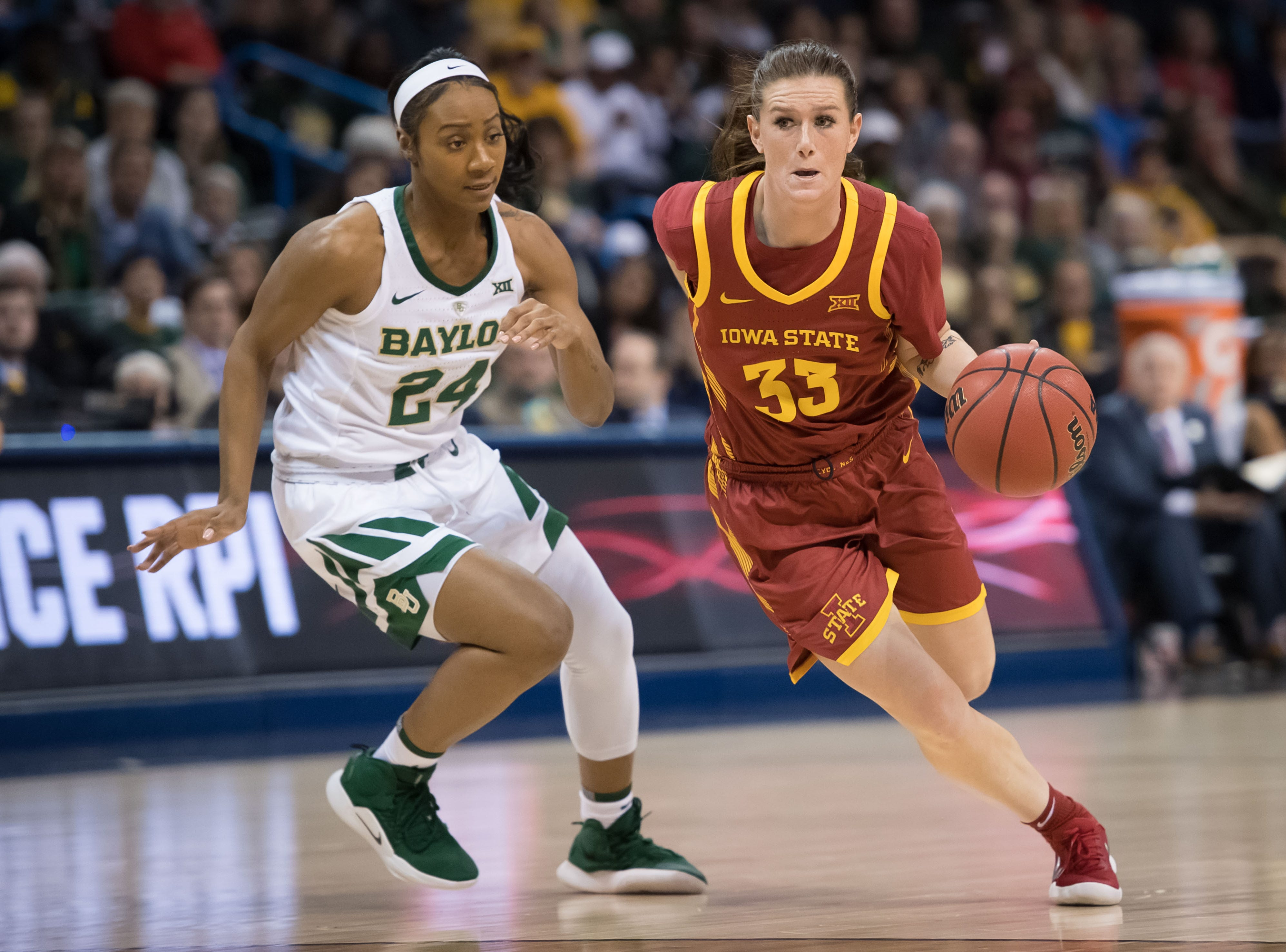 Iowa State Cyclones guard Alexa Middleton (33) dribbles past Baylor Lady Bears guard Chloe Jackson (24) during the third quarter in the women's Big 12 Conference Tournament at Chesapeake Energy Arena.