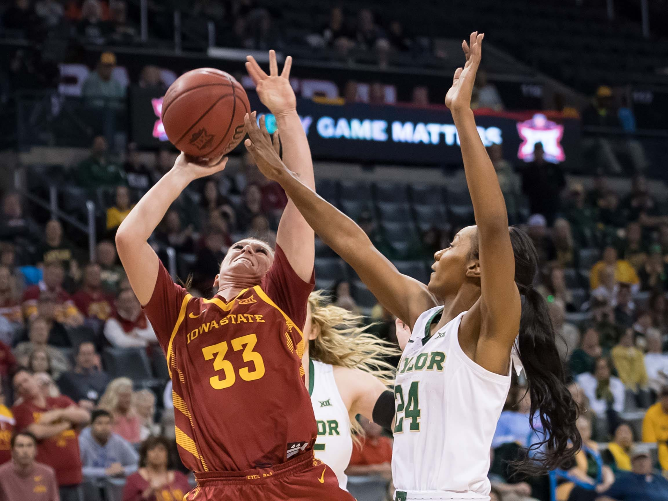 Iowa State Cyclones guard Alexa Middleton (33) shoots the ball while defended by Baylor Lady Bears guard Chloe Jackson (24) during the third quarter in the women's Big 12 Conference Tournament at Chesapeake Energy Arena. Baylor won 67-49.