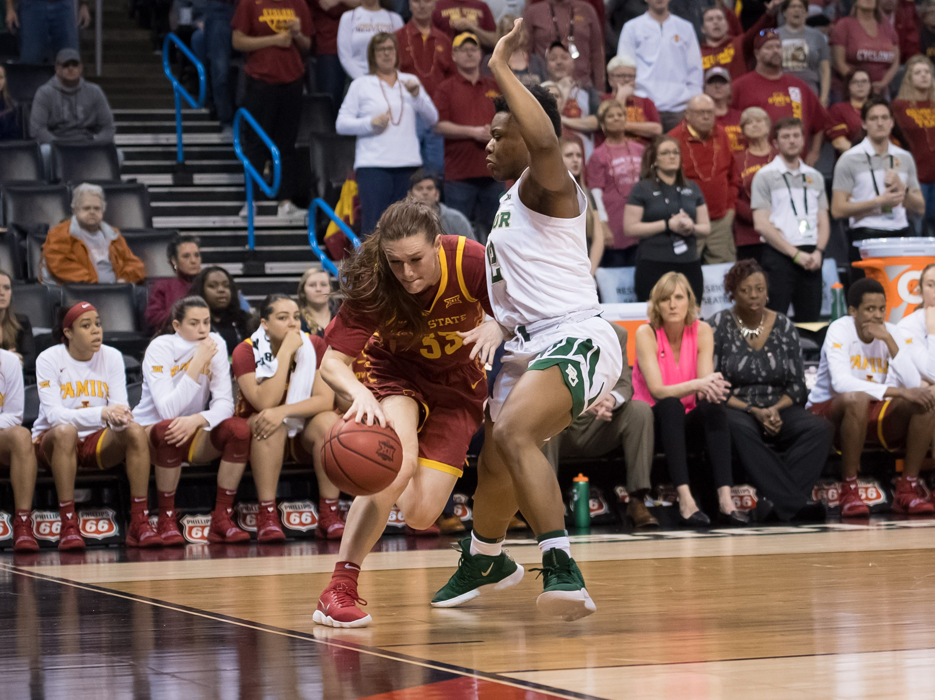 Iowa State Cyclones guard Alexa Middleton (33) dribbles past Baylor Lady Bears guard Moon Ursin (12) during the fourth quarter in the women's Big 12 Conference Tournament at Chesapeake Energy Arena. Baylor won 67-49.