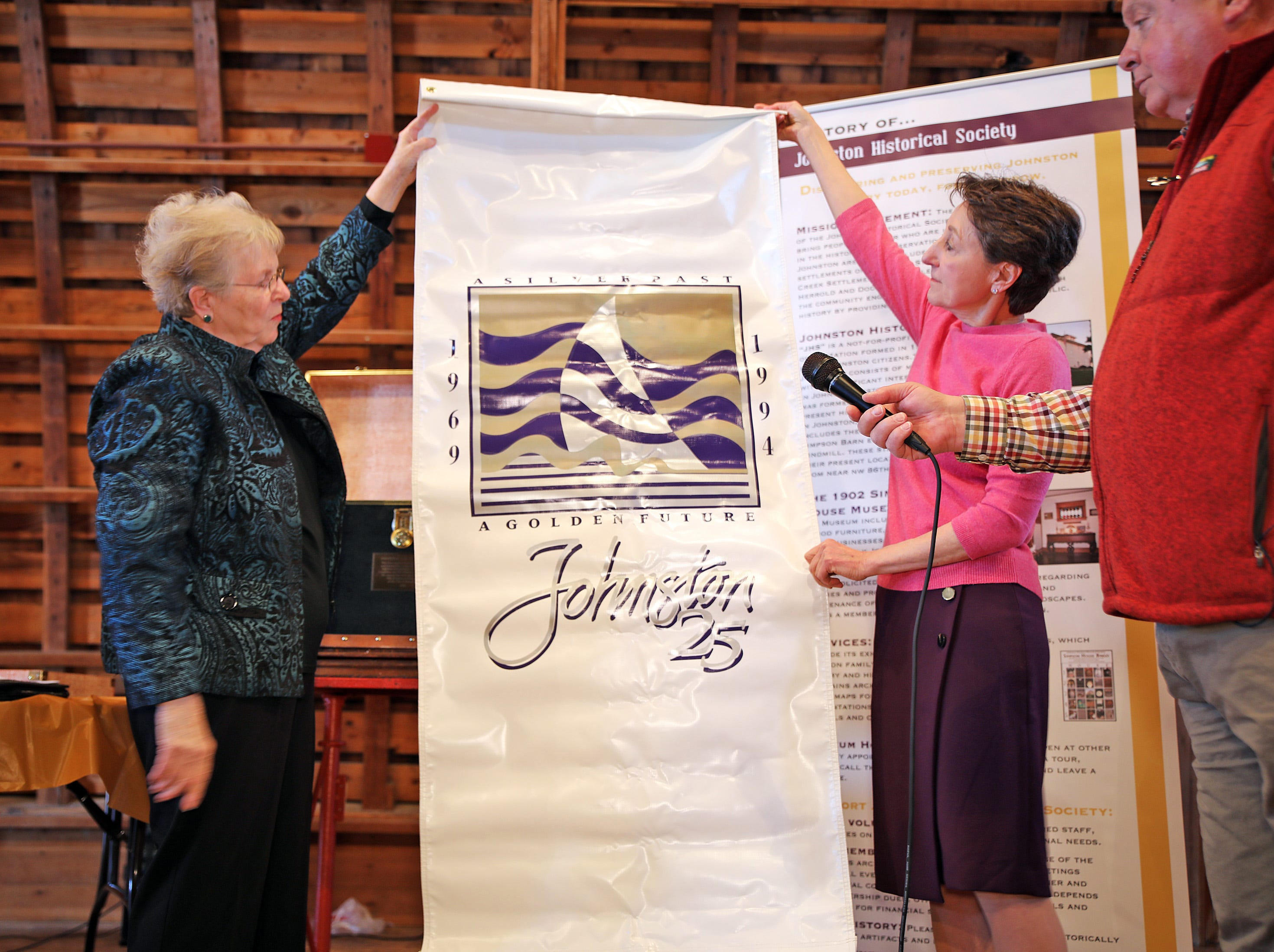 Past President of the Johnston Historical Society Mary Jane Paez and Johnston Mayor Paula Dierenfeld unveil a promotional banner from 1994 during the opening of the 25-year old time capsule from 1994 as the city of Johnston celebrates its 50th anniversary at the Simpson House and Barn Museum at 6161 Northglenn Drive on Sunday, March 10, 2019, in Johnston. The city was incorporated in 1969 with 2,236 residents and 50 years later, over 21,000 residents call Johnston home.