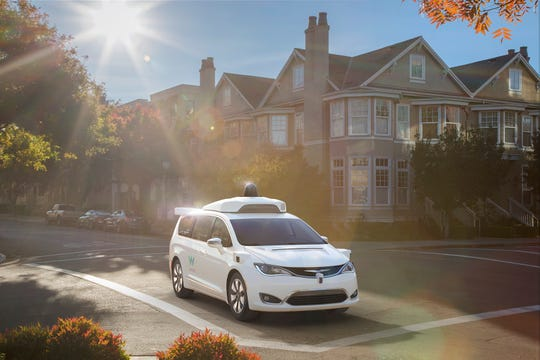 The self-driving Waymo Chrysler Pacifica minivan has a roof-pod full of sensors.