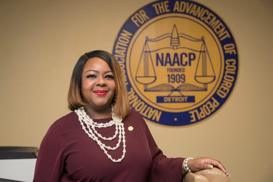 Kamilia Landrum, executive director of the NAACP Detroit branch poses for a photo in her office in Detroit, Wednesday, Feb. 13, 2019.