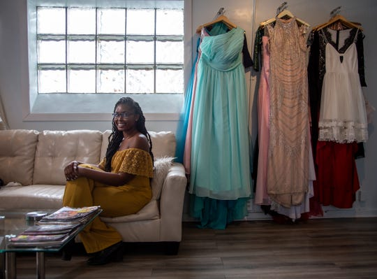 Lori LeeAnne Conerly, owner of LeeAnne's Luxury Bridal Boutique, poses for a photo in her business on Wednesday, March 6, 2019 on Detroit's west side.