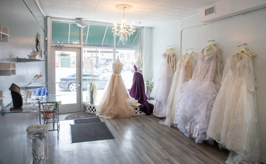 Sample dresses hang on display at LeeAnne's Luxury Bridal Boutique on Detroit's west side on Wednesday, March 6, 2019.