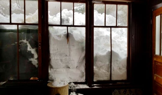Deep snow is accumulating on Debbie Fyvie's back porch in Rockland, Michigan, in the Upper Peninsula.