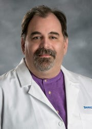 Dr. Matthew Sims, director of infectious diseases research at Beaumont Health.