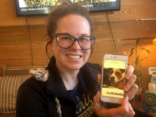 Melody Simmons of Ypsilanti, showing off a photo of her mixed breed Lucy, who gets cannabis-based products to help with anxiety while at at Bloom City, in Ann Arbor on March 8, 2019.