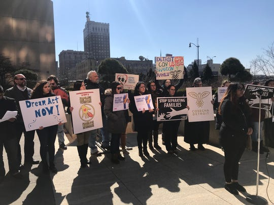 Nelly Gudino, of Grand Rapids, speaks at a rally and press conference outside the federal McNamara building in Detroit on March 12, 2019. She is joined by other immigrant and Latino advocates concerned about ICE arrests of immigrants. Gudino is a cousin of two immigrants arrested and detained in Feb. by ICE, Brandon Reyes, 22, and his mother, Marilu Parra-Velazquez, 41.