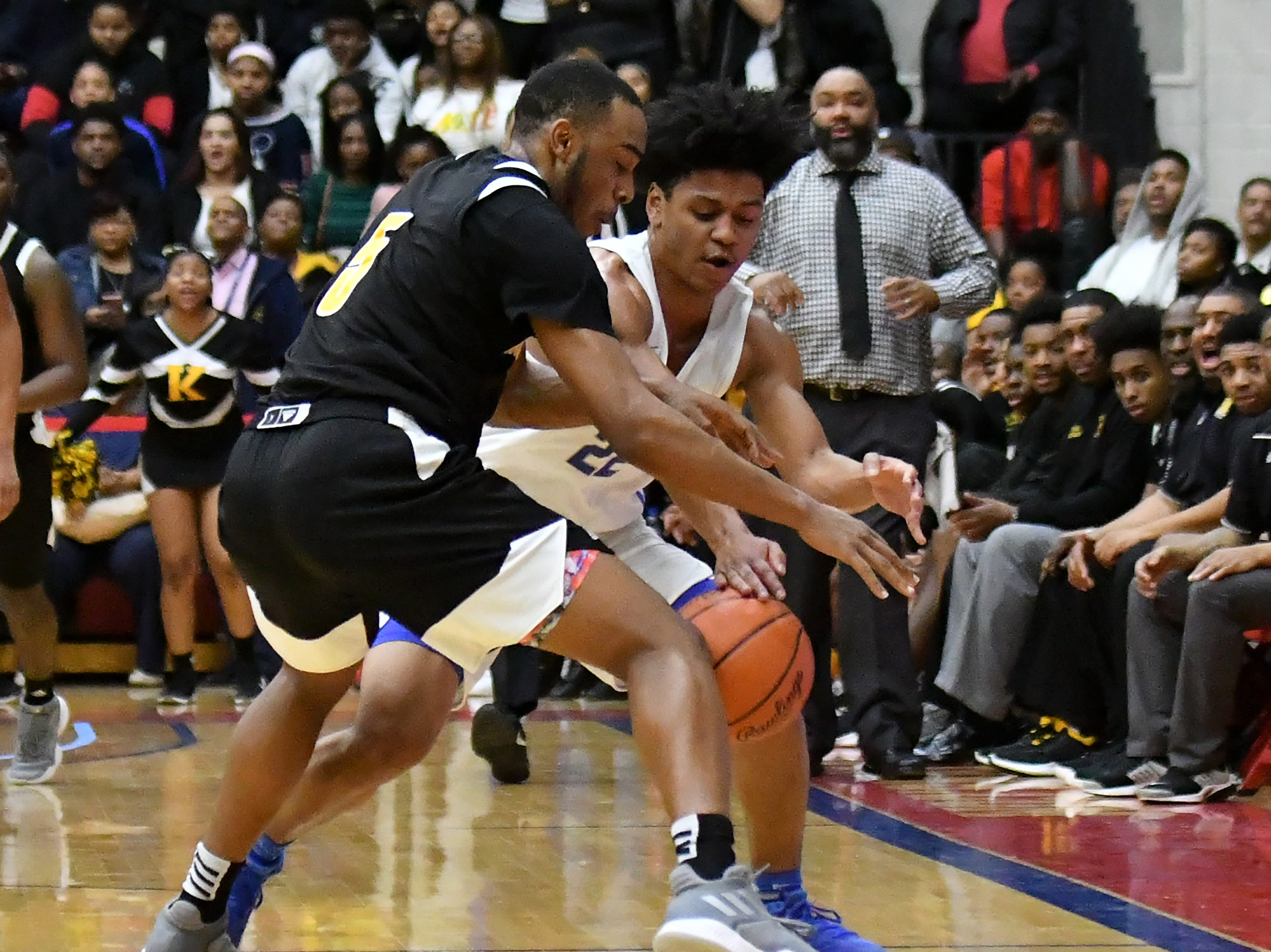 King's John Massey, Jr. almost steals the ball from Lincoln's Ibn Abdul-Rahman (22) in the last minute of the game in the second half.