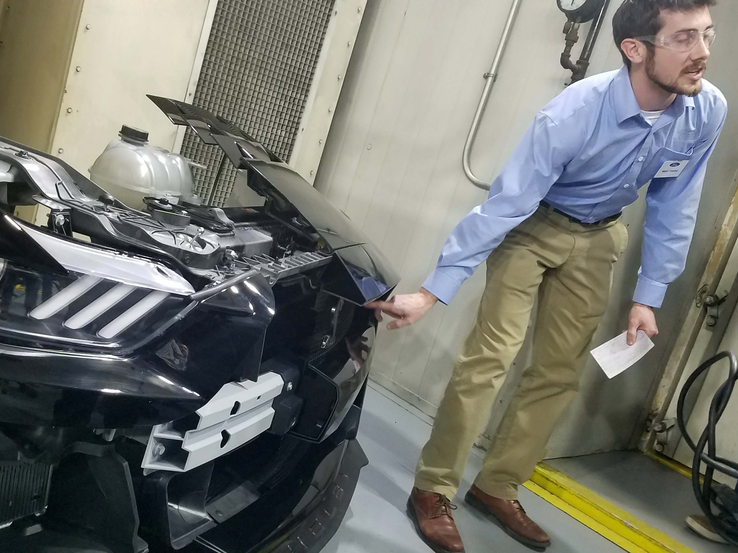 Mustang Vehicle Dynamics Supervisor Matt Trantor points out the 6 heat exchangers found on the front clip of the 2020 Ford Mustang GT500.