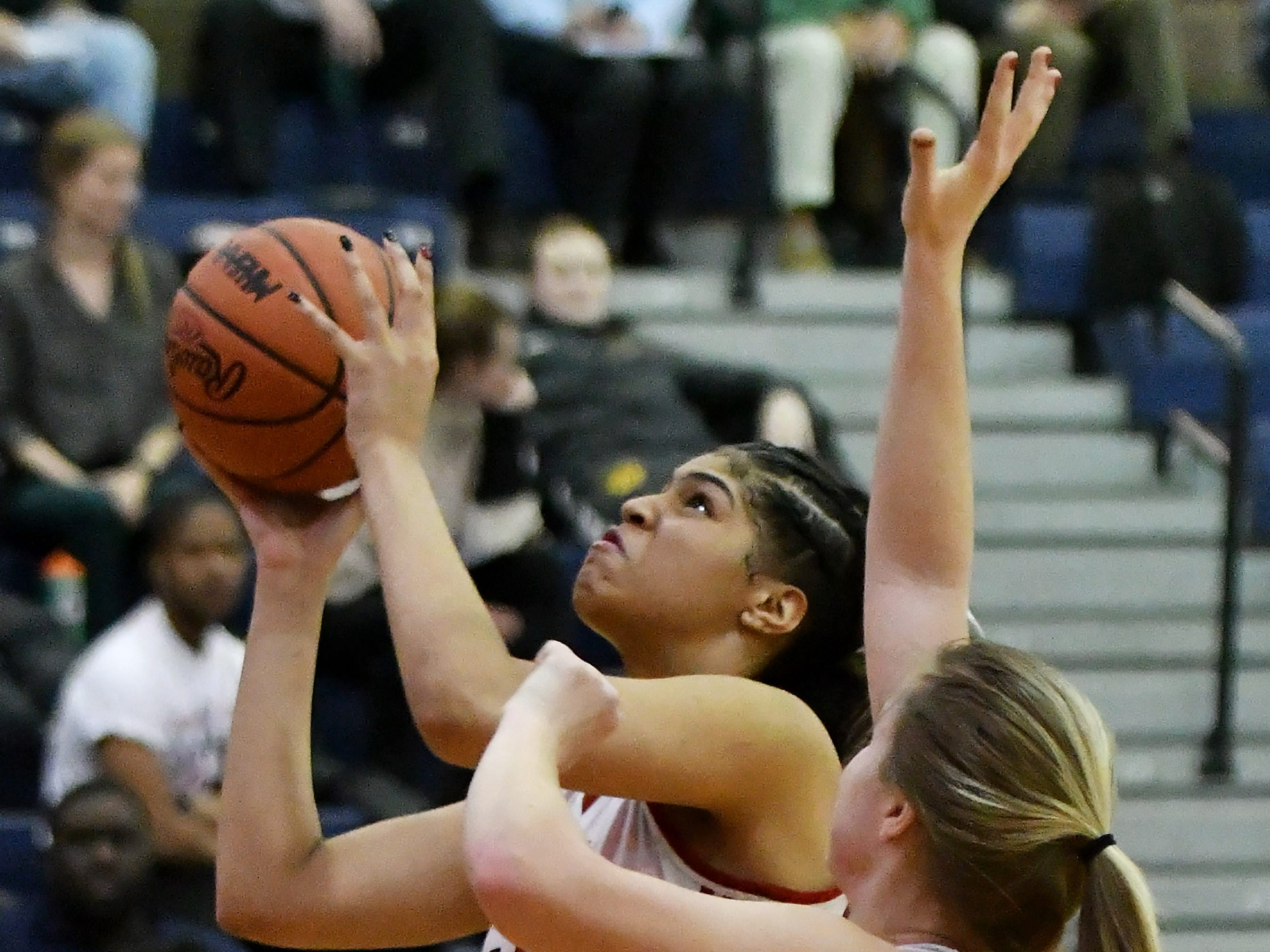 Warren Cousino's Olivia Joliffe (21) defends a shot by Southfield A&T's Jasmine Worthy in the second half.