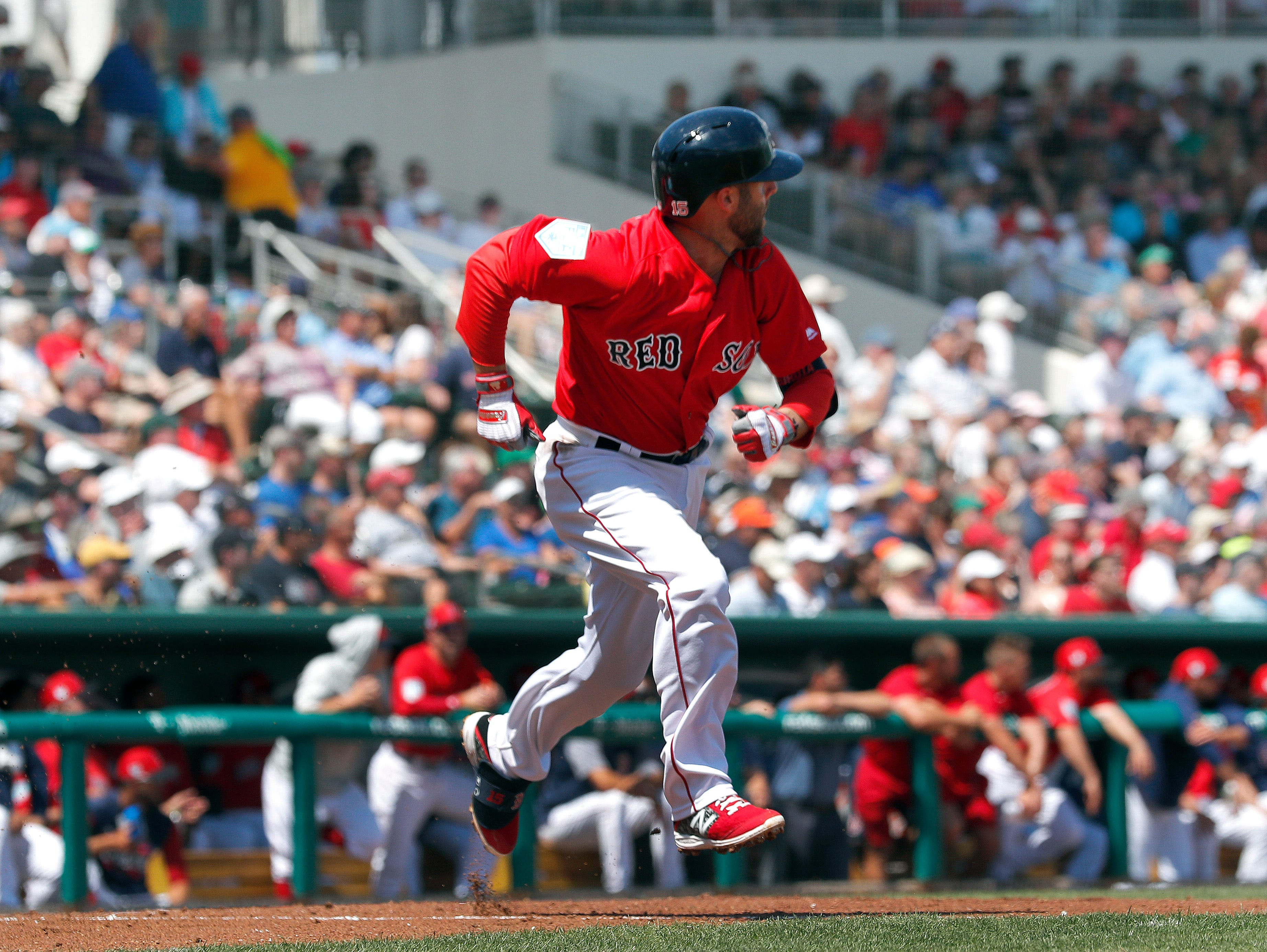 Dustin Pedroia of the Boston Red Sox runs to first with a base hit in the first inning.